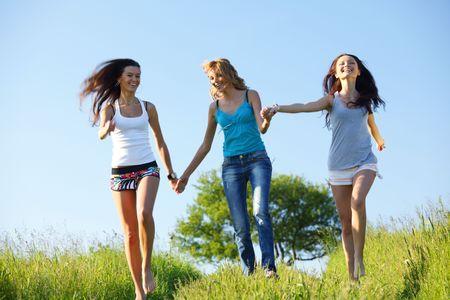 women fun on grass field photo