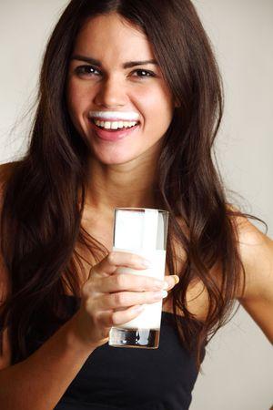 woman drink yogurt close up photo
