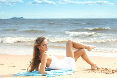 woman laying on sand sea on background Stock Photo - 6315842