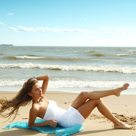 woman laying on sand sea on background Stock Photo - 6315713