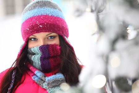 woman in winter hat and holyday bokeh Stock Photo - 6360387
