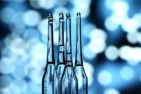 ampoule on abstract bokeh background photo