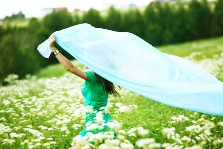 girl run  fabric in she hands photo