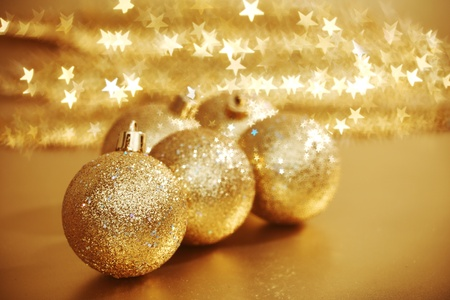 golden christmas ball on golden star bokeh background Stock Photo - 8366645