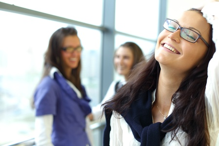 Student meeting smiley girl face on foreground Stock Photo - 8366769