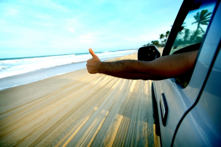 yellow car: beach drive on allroad car Stock Photo