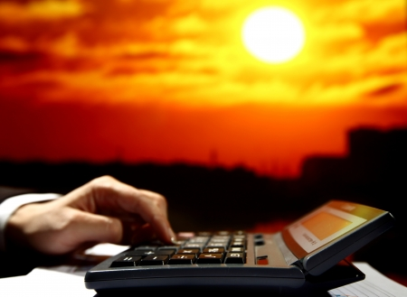 reseller early work calculate price skyscrapers under sunset Stock Photo - 8406939