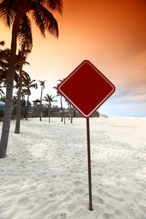 desert sign in sand under palm Stock Photo - 8415529