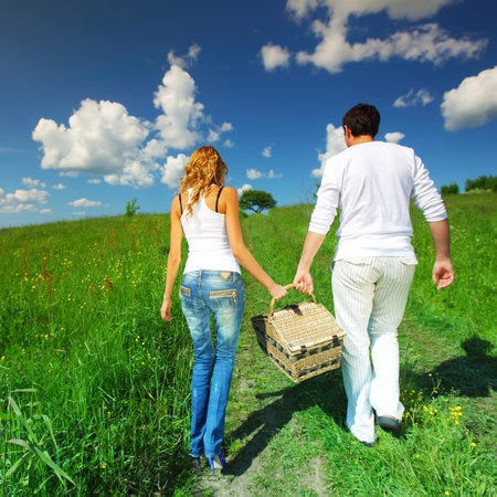 lovers go to picnic by green hill Stock Photo - 8415619