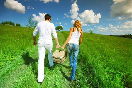 lovers go to picnic by green hill Stock Photo - 8415672