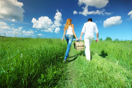 lovers go to picnic by green hill Stock Photo - 8415667