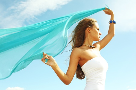 woman fly in the blue sky by fabric Stock Photo - 8415926