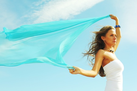 woman fly in the blue sky by fabric Stock Photo - 8415907