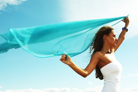 woman fly in the blue sky by fabric Stock Photo - 8415706
