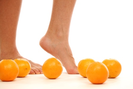 leg and oranges isolated white background Stock Photo - 8415830