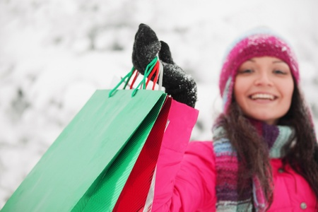 gift bags: winter girl with gift bags on snow background