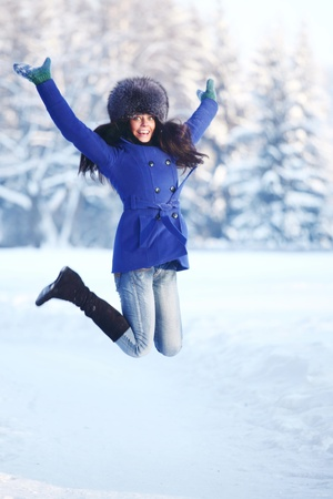 winter women jump in snow Stock Photo - 8437882