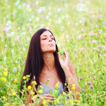 happy woman smile in green grass soap bubbles around Stock Photo - 8439380