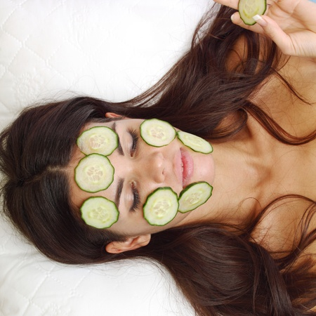 cucumbers circles on a girl face Stock Photo - 8439464
