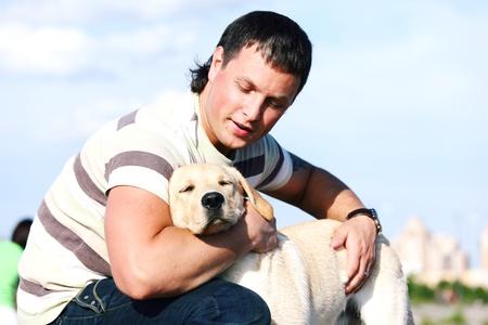 man and dog blue sky on background photo