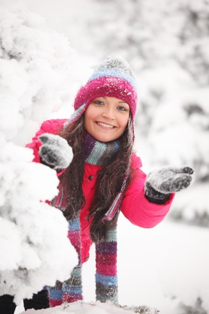 winter girl behind snow tree  Stock Photo - 8438170