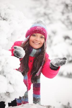 winter girl behind snow tree Stock Photo - 8438170