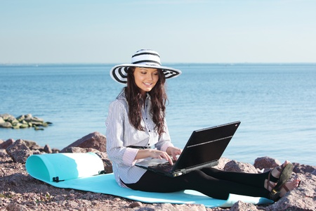 woman with laptop sea background Stock Photo - 8439425