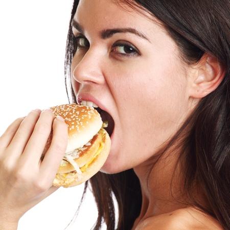 woman eat burger isolated on white background photo