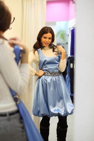 changing: woman in dress room wear dress