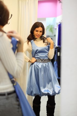 tight dress: woman in dress room wear dress