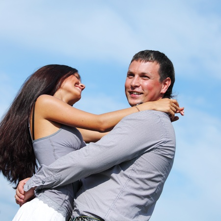 man and woman hug in the sky photo