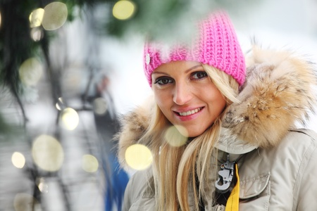 woman in winter hat and holyday bokeh photo