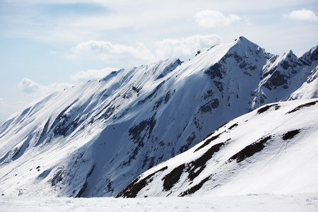 top of mountains in blue sky Stock Photo - 8525513