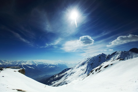 snowy mountain: top of mountains in blue sky Stock Photo