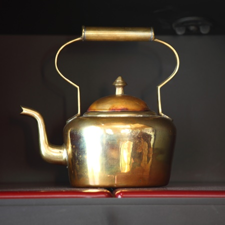 old container: tea in brass pot close up Stock Photo