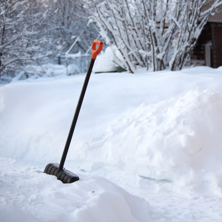 heap snow: shovel in snow on nature Stock Photo