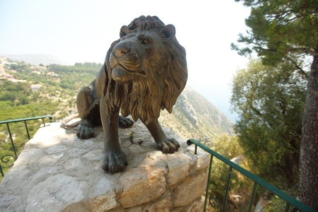 lion statue in park park on background photo