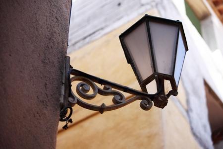 lantern on house wall background photo