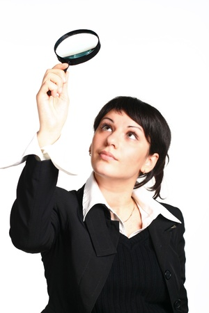 The business girl searches for something through a magnifier Stock Photo - 8513975
