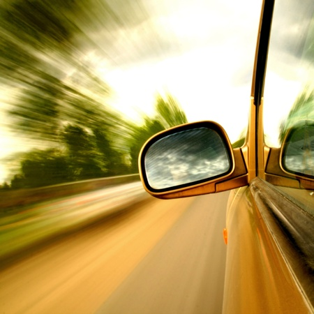rear view mirror: need for speed transportation background Stock Photo