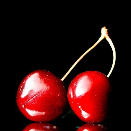 cherry on black background close up