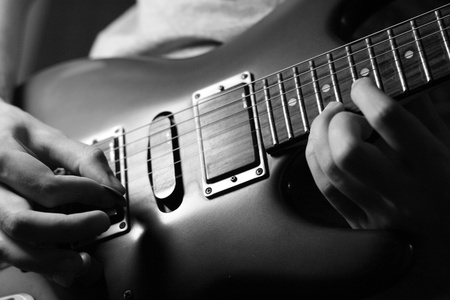 blues: man play solo on blue guitar