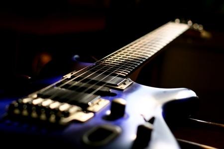 guitar head strings macro on black photo