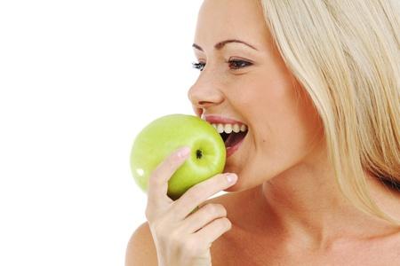 blond woman eat green apple on white photo