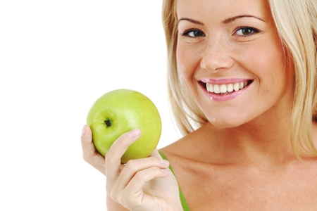 blond woman eat green apple on white Stock Photo - 8585681