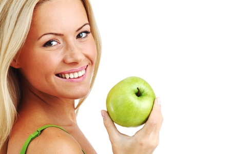 blond woman eat green apple on white Stock Photo - 8585722