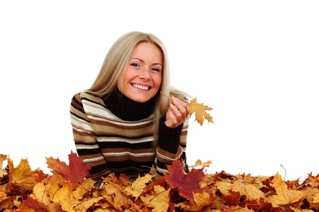 lying in leaves:  studio portrait of autumn woman in  yellow leaves
