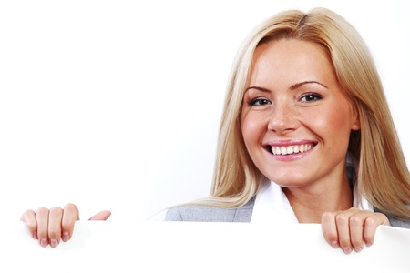 business woman hidden behind a white sheet of paper Stock Photo - 8585080