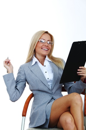 sexy teacher: business woman hold a folder of papers  and write