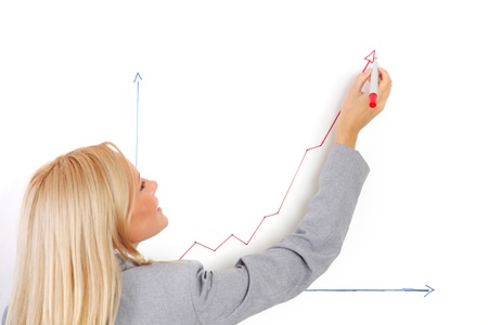 seminar: business woman draws a graph on the wall